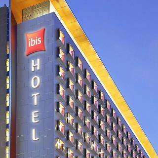 ibis hotel façade by sunset